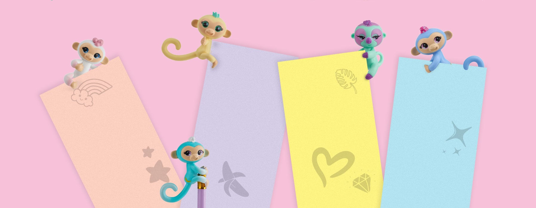 Fingerlings Minis playfully climbing over construction paper cut outs